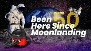an astronaunt on the moon swiping the surface with a henry vacuum cleaner